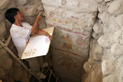 Archaeologist and painter Pedro Neciosup illustrates a painted pillar at Pañamarca